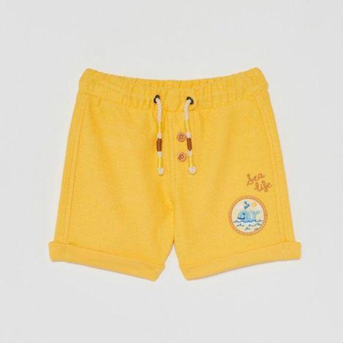Bermuda lisa con cintura ajustable de cordón y parche bordado niño