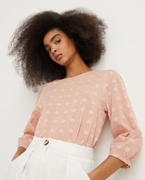 Blusa con textura color rosado