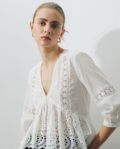 Blusa cuerpo escote pico schiffly blanco