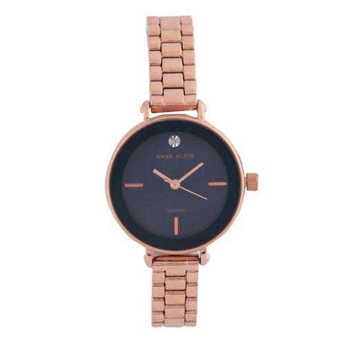 Reloj análogo dorado rosa